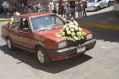Flowers on old wedding car Stock Photo
