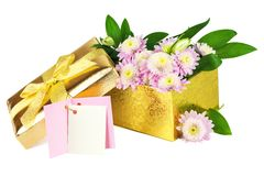 Flowers in the open golden box. Spring flowers in the open golden box with card isolated on white background Stock Images