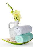 Flowers orchid, massage stones and towels for spa Royalty Free Stock Images