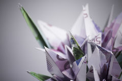 Flowers origami banknotes Stock Photos
