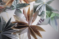 Flowers origami banknotes Stock Photo