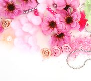 Flowers and ornaments. Pink flowers and ornaments on a white background stock photography