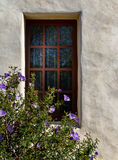Window on a stucco wall Stock Images