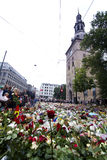 Flowers outside church in Oslo after terror. Panorama: 25. july people gather in mourning outside the Oslo Domkirke in downton Oslo after the two terror attacks Stock Images