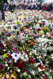 Flowers outside church in Oslo after terror. 25. july people gather in mourning outside the Oslo Domkirke in downton Oslo after the two terror attacks that hit Stock Photos