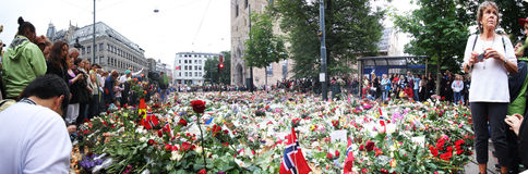 Flowers outside church in Oslo after terror. Panorama: 25. july people gather in mourning outside the Oslo Domkirke in downton Oslo after the two terror attacks Stock Photography