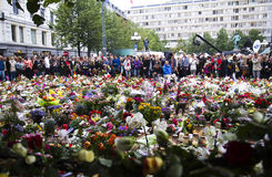 Flowers outside church in Oslo after terror 3. Panorama: 25. july people gather in mourning outside the Oslo Domkirke in downton Oslo after the two terror Stock Photography