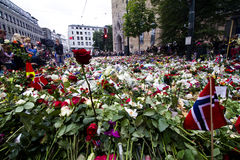 Flowers outside church in Oslo after terror 4. Panorama: 25. july people gather in mourning outside the Oslo Domkirke in downton Oslo after the two terror Royalty Free Stock Photos