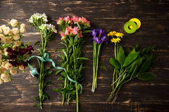 Flowers over wood background. From above. Stock Photos