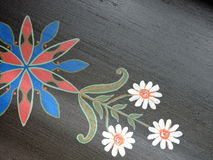 Flowers painted on desk Stock Photos