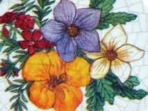 Flowers painted on old plate Stock Photo