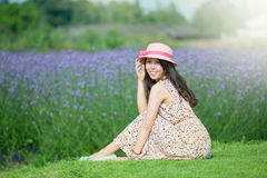 Flowers and a pair of smiling girl Royalty Free Stock Photos