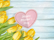 Flowers and paper heart. EPS 10. Bunch of flowers and paper heart with text on wooden background. Happy Mothers Day. EPS 10 vector file included Stock Images
