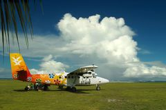 Flowers on paradise plane. Couds, sea island. stock image