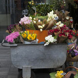 Flowers in parcel  in a flower shop on a market Stock Images