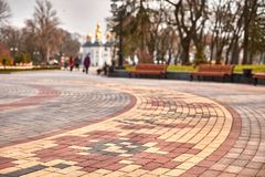 Flowers from paving slabs laid out in an arc on the back blurred background beautiful park stock photo