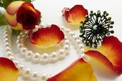 Flowers and pearls. Jewelry and flowers over white background Stock Photo