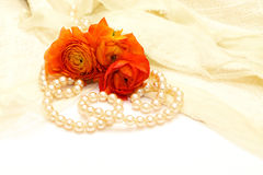 Flowers and pearls on the lace stock photo