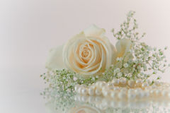 Flowers and pearls on white background Royalty Free Stock Photos
