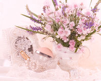 Flowers with perfume bottles Royalty Free Stock Photos