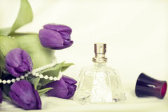 Flowers and perfume. Retro photo Royalty Free Stock Photography