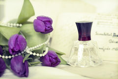 Flowers and perfume. Retro photo Stock Images