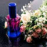 Flowers and perfumes Stock Image