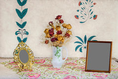 Flowers and Picture Frames Stock Photography