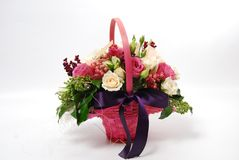 Flowers in a pink basket. With white and pink roses Stock Photo