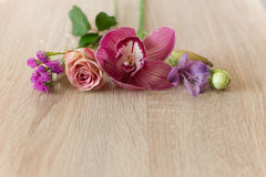 Flowers pink  on a dark wooden Royalty Free Stock Images
