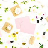 Flowers, pink envelope, cosmetics and gifts on white background. Flat lay, top view. Valentines day concept. Flowers, pink envelope, cosmetics and gifts on white royalty free stock image