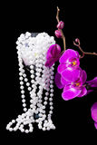 Flowers of pink  orchid and beads from white pearls Royalty Free Stock Photos