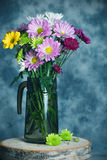 Flowers in pitcher Stock Photos