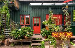 Flowers and plant of traditional village house of Christiania Freetown with garden accessories and bicycle stock images