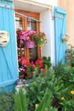 Flowers and plants decorating house exterior. Stock Photos
