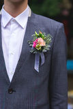 Flowers in a pocket at the groom Stock Photography