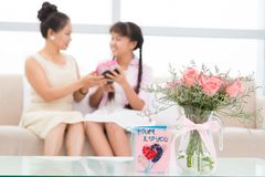 Flowers and a postcard for mum's day Royalty Free Stock Photo