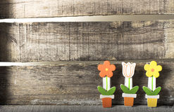 Flowers in a pot on wooden background. Wooden flowers in a pot on wooden background Royalty Free Stock Photos