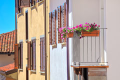 Flowers in the pots on house balcony in Italy. Stock Image