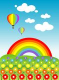 Flowers and rainbow. A meadow full of coloured flowers with a rainbow and two hot-air balloons on the background Royalty Free Stock Photos