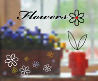 Flowers and a red watering can Royalty Free Stock Image