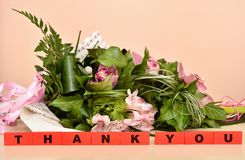 Flowers and red wooden blocks with Thank You message stock photography