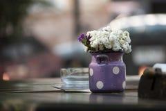 Flowers in retro bucket on wooden table. Picture of flowers in retro bucket Royalty Free Stock Image