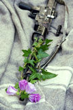 Flowers in the rifle. Barrel military Royalty Free Stock Photos