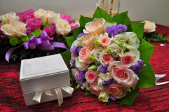Flowers And A Ring Box. A photo of a bouquet of flowers and a box holding rings royalty free stock photography