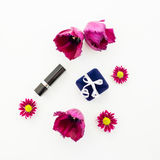 Flowers, ring box and women`s accessories isolated on white background. Flat lay, Top view Stock Photo