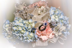 Flowers and rings. A bouquet of flowers and rings stock photos