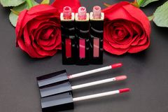 Flowers rose,Powder and lipstick brush uses lips  on black backg Royalty Free Stock Photography