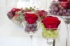 Flowers rose in wine glass  goblet Stock Photos
