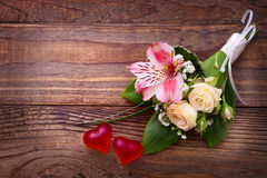 Flowers rose on wooden surface. Royalty Free Stock Photo